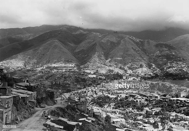 Slum housing sprawling up the hillside on the outskirts of Caracas Venezuela Due to the Venezuelan oil industry the country has become one of...