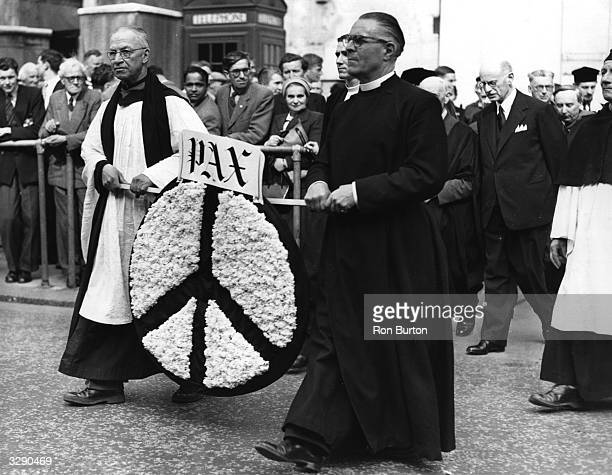 Father Jack Futrill and Dr Soper carrying a wreath to the Cenotaph prior to taking part with other clergymen in the 'Lobbying' for Nuclear...
