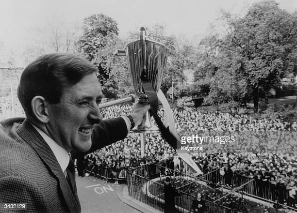 Tottenham Hotspur and Northern Ireland footballer Danny Blanchflower holding the European Cup outside Tottenham Town Hall during a civic reception