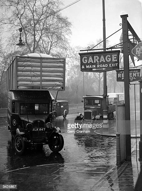 A coal gas powered Fordson van in a garage in Bayswater London