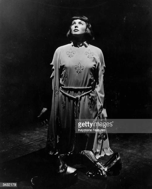 Swedish actress Ingrid Bergman as Joan of Arc pledging her weapons of war to God after her great victories