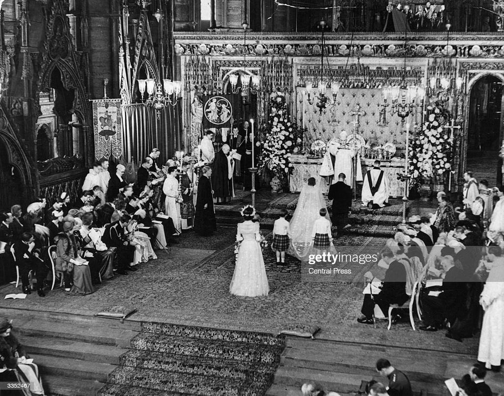 Princess Elizabeth and The Duke Of Edinburgh kneeling in front of the Archbishop of Canterbury during their marriage ceremony in Westminster Abbey.