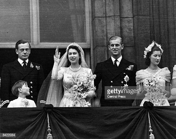 Princess Elizabeth and the Duke of Edinburgh on the balcony of Buckingham Palace London waving to the crowd shortly after their wedding at...
