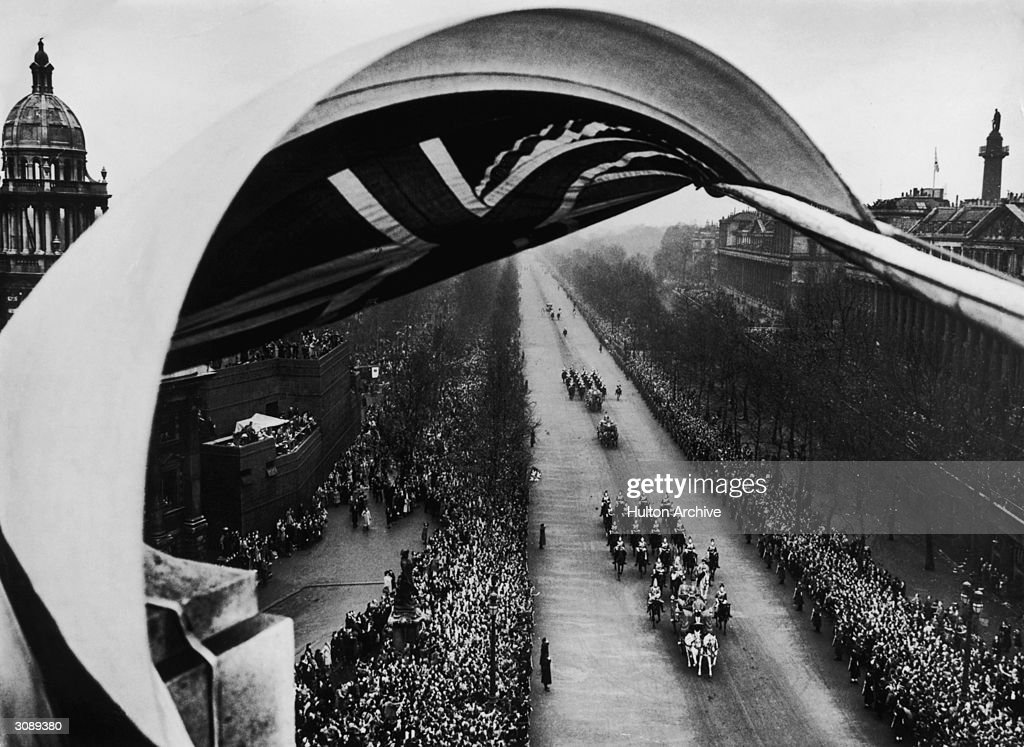 Princess Elizabeth is driven along the Mall to Westminster Abbey in the Irish Coach with a sovereign's escort of the Household Cavalry for her marriage to Philip Mountbatten.