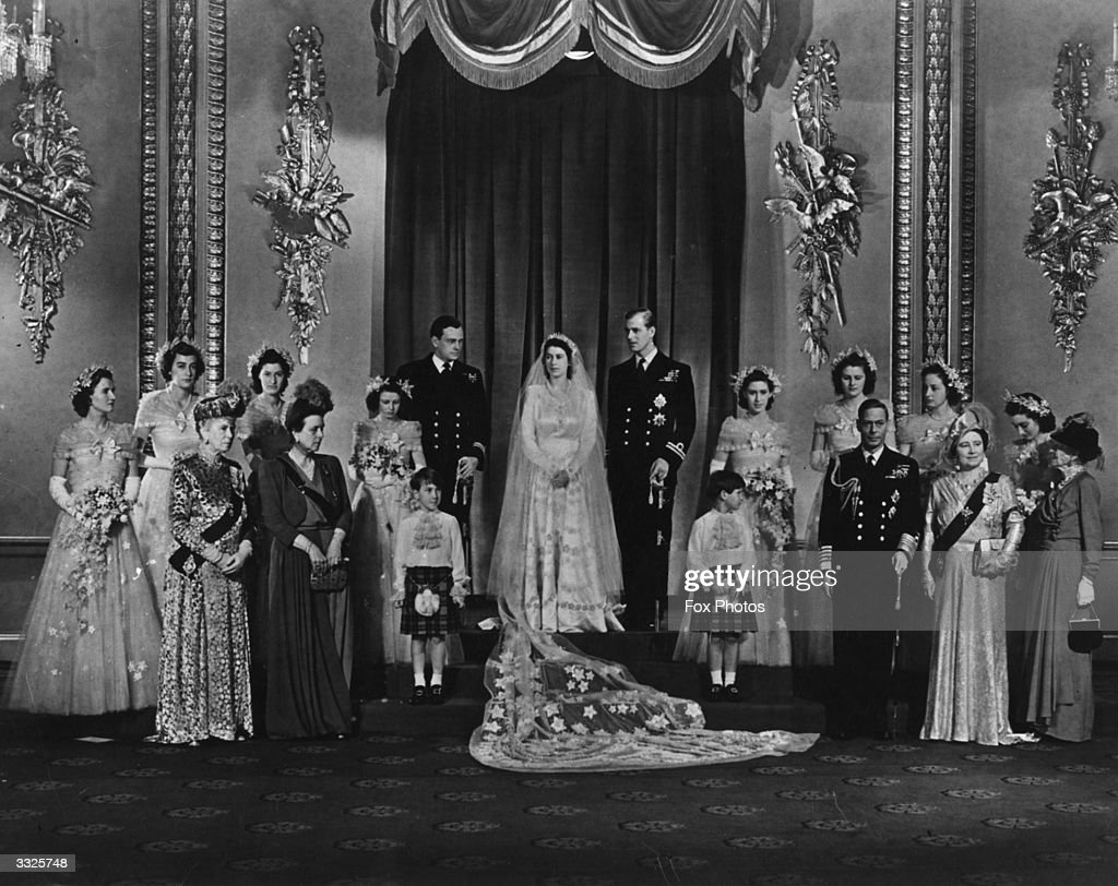 Queen Elizabeth (as Princess Elizabeth) and Prince Philip, Duke of Edinburgh (centre) on their wedding day, surrounded by members of the Royal Family. The guests include Queen Mary (third from left), Princess Margaret (beside Prince Philip), King George VI (third from right, front row) and Queen Elizabeth the Queen Mother (1900 - 2002), next to him.