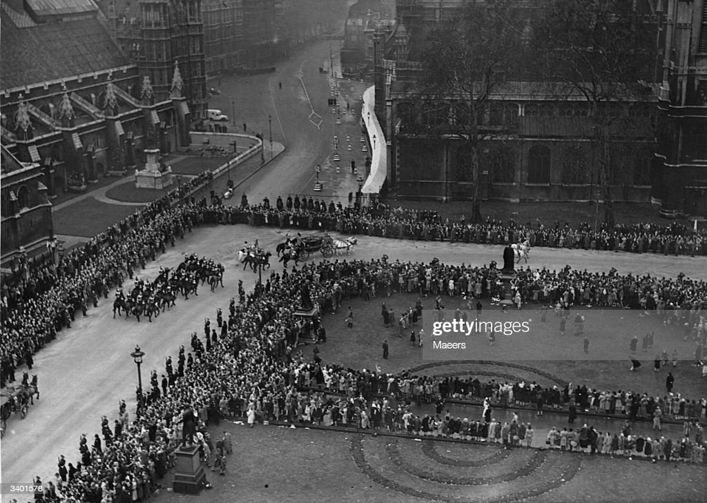 The bride's coach arriving at Westminster Abbey for the royal wedding between Princess Elizabeth (later Queen Elizabeth II) and the Duke of Edinburgh.