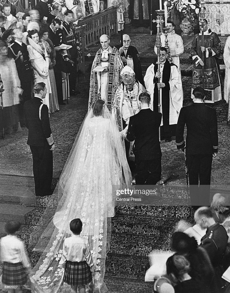 The Queen and The Duke of Edinburgh receiving a blessing from the Archbishop of Canterbury Lord Fisher (1887 - 1972) on the occasion of their wedding.