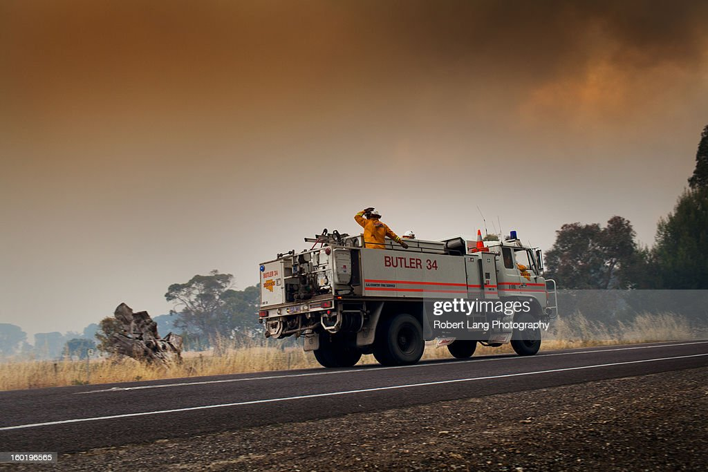 CONTENT] 20th November 2012, Coomunga, Eyre Peninsula: A Country Fire Service truck from the Butler Tanks district pitches in an equal share in the fire fighting efforts, all the while a volunteer fighter hangs on tightly to his safety helmet to combat the high speeds his driver must maintain.