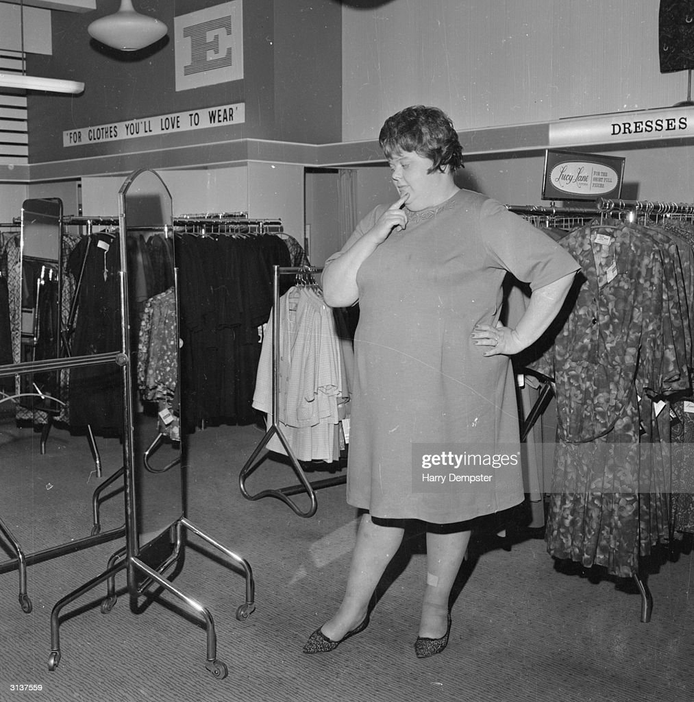Mrs June Webb, the founder of the 'Big Girl Club' shops at a clothing store which specialises in outsize garments.