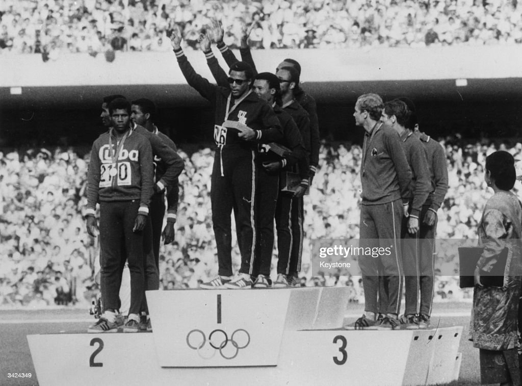 The American 4x100 metres relay winners (Charles Greene, Melvin Pender, Ronnie Ray Smith, James Hines) wave to the crowd after receiving their gold medals at the 1968 Mexico Olympics. Cuba won silver and France bronze.