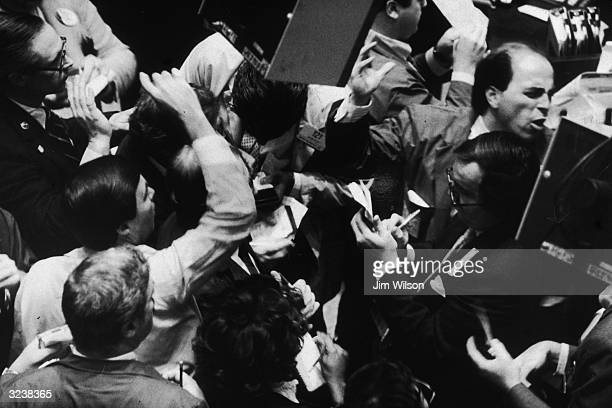 Highangle view of traders on the floor of New York Stock Exchange the day the Dow Jones posted a record oneday point rise New York City