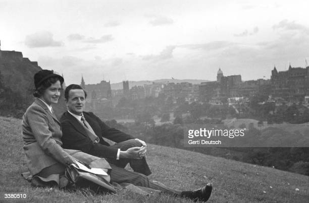 Contralto Kathleen Ferrier and English tenor Peter Pears sitting on a hillside overlooking Edinburgh while visiting the city for its famous festival...