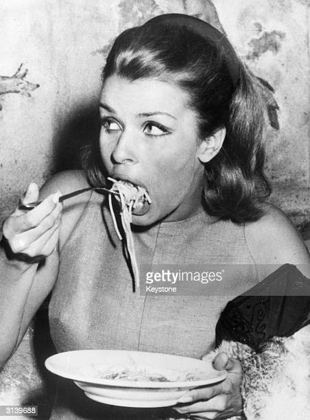 Austrian actress Senta Berger enjoying a plate of spaghetti at the Cinecitta in Rome during the filming of 8Operation Saint Gennarioe