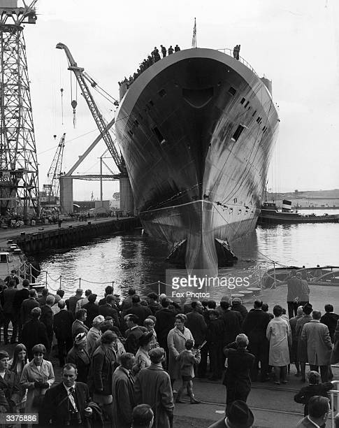 The Cunard liner 'Queen Elizabeth II' is moved into a fittingout berth following its launch at John Brown's shipyard at Clydebank in Scotland The...