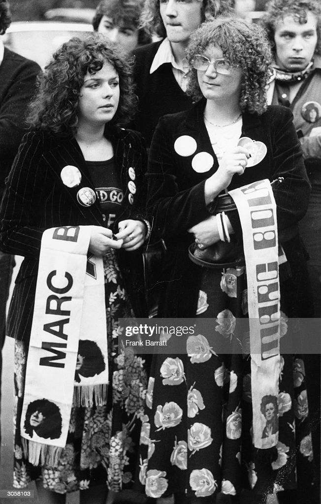 Two young female fans attend the funeral of glam rock singer Marc Bolan at Golders Green Crematorium, London.
