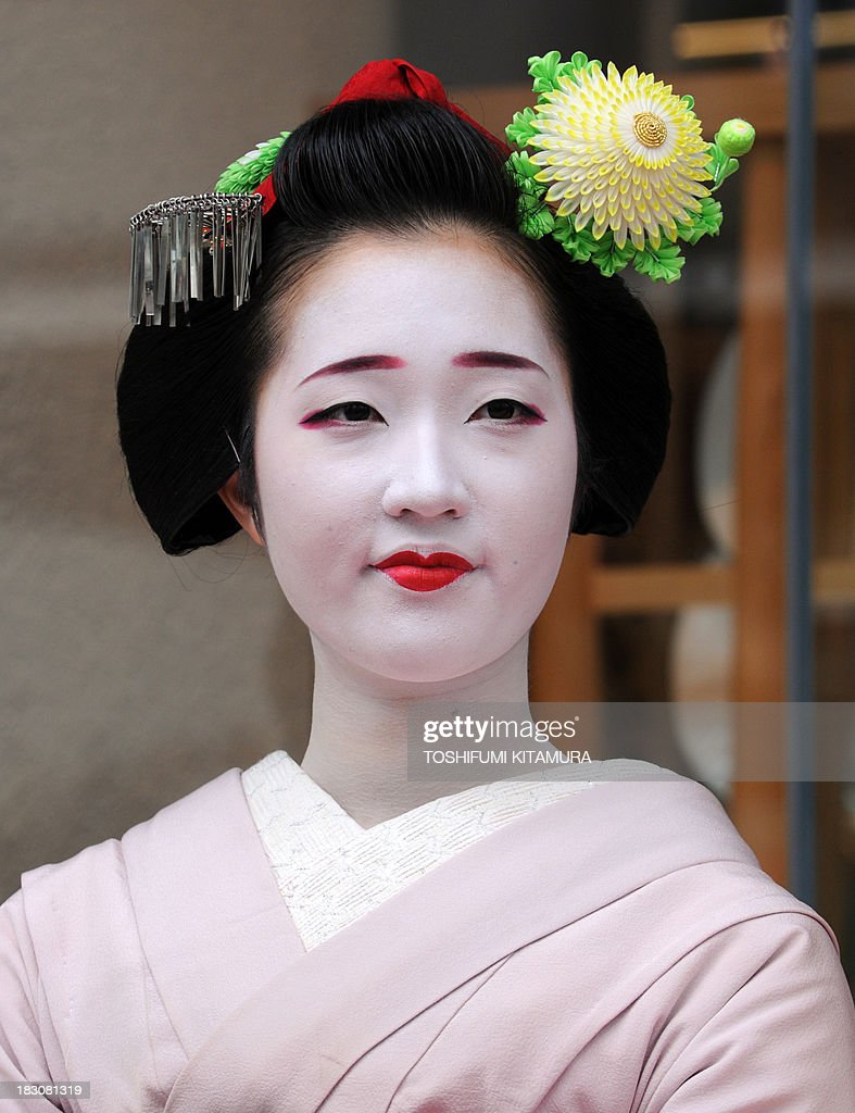 20-year-old Chizu, a 'Maiko,' or apprentice geisha, from Ponto cho attends the 'We're alive and well, Kyoto' campaign in Tokyo on October 4, 2013. As Kyoto prepares itself for the biggest sightseeing season of autumn, the girls lent their charms to lure back tourists to the 1,200-year-old city after a big typhoon flooded some of scenic spots there three weeks ago.