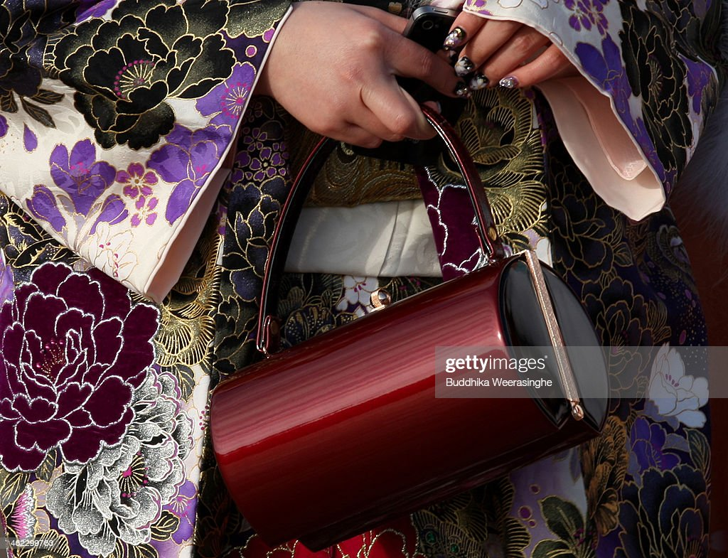 20-year-old Japanese woman dressed in traditional clothe and hold bag during the Coming of Age Day ceremony at Cultural Hall on January 13, 2014 in Himeji, Japan. The Coming of Age Day is a Japanese holiday to congratulate and encourage young people who have reached the age 20 as maturity in Japan, when they are legally permitted to smoke, drink alcohol and vote.