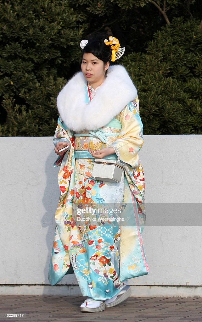 20-year-old Japanese woman dressed in traditional clothe attends the Coming of Age Day ceremony at Cultural Hall on January 13, 2014 in Himeji, Japan. The Coming of Age Day is a Japanese holiday to congratulate and encourage young people who have reached the age 20 as maturity in Japan, when they are legally permitted to smoke, drink alcohol and vote.