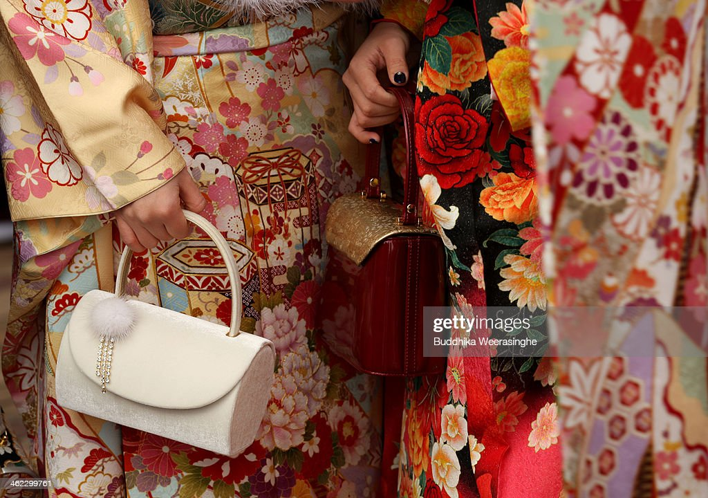 20-year-old Japanese women dressed in traditional clothes and hold bag during the Coming of Age Day ceremony at Cultural Hall on January 13, 2014 in Himeji, Japan. The Coming of Age Day is a Japanese holiday to congratulate and encourage young people who have reached the age 20 as maturity in Japan, when they are legally permitted to smoke, drink alcohol and vote.