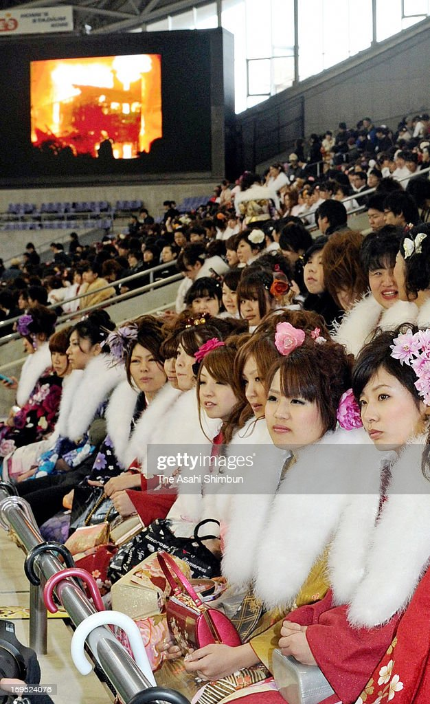 20-year-old Kobe people, wearing Kimono watch the video of Hanshin Awaji Great Earthquake in 1995, during the Coming-of-age ceremony on January 14, 2013 in Kobe, Hyogo, Japan. The event involves 20-year-old Japanese people celebrating their eligibility to drink alcohol, smoke and vote.