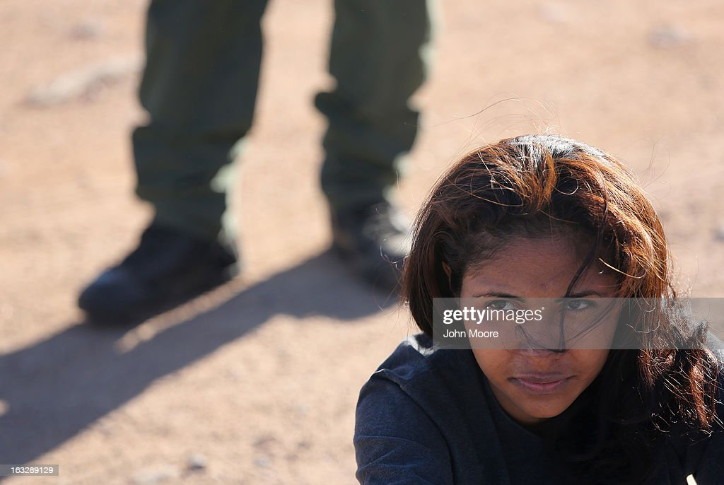 A 20-year-old Mexican immigrant sits under U.S. Border Patrol supervision after her group was caught after crossing into the United States on March 6, 2013 near Walker Canyon, Arizona. Due to broad federal sequestration budget cuts, Border Patrol agents are expected to begin taking unpaid furlough days in April, as Customs and Border Protection funding is expected to be reduced by more than $500 million.