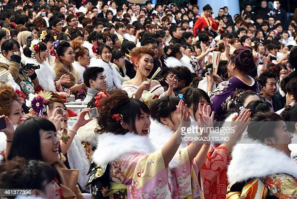 20yearold women wearing kimonos watch a show by Disney characters during their 'ComingofAge Day' celebration at Tokyo Disneyland in Urayasu suburban...