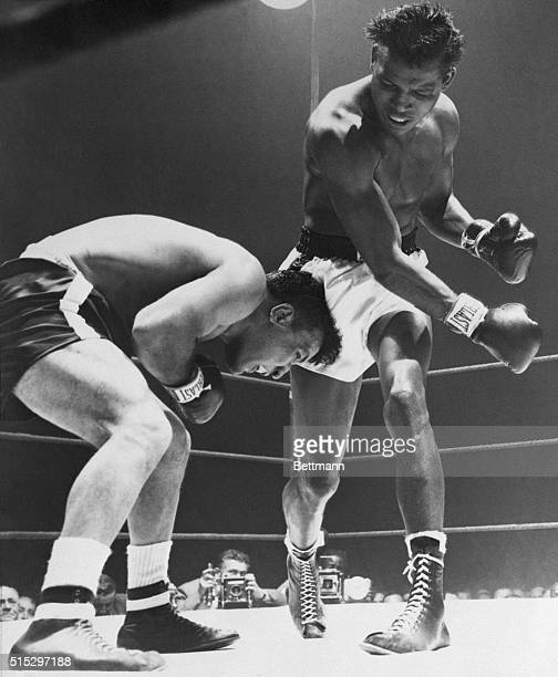 2/14/1951Chicago IL The hammering fists of Sugar Ray Robinson beat down the head of desperately weaving Jake LaMotta In this third round action...