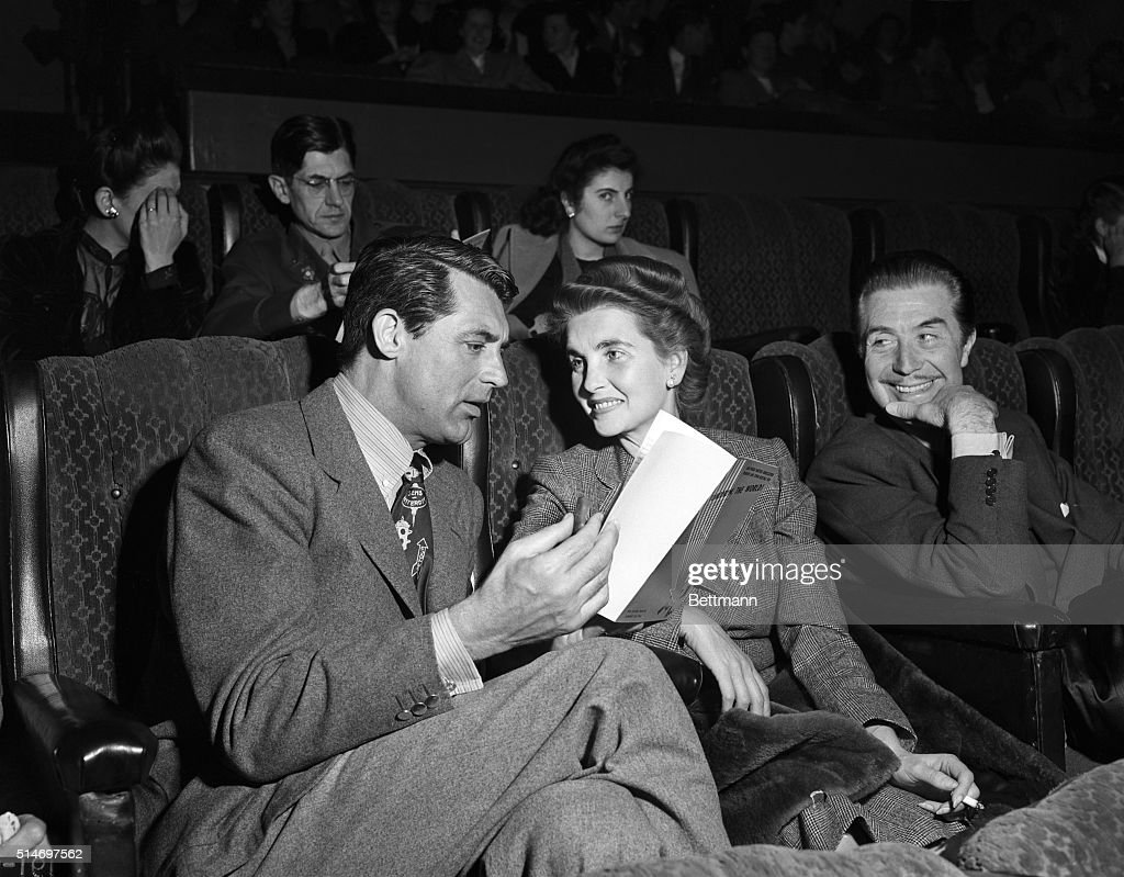 Photographed together for the first time since their recent separation and reconciliation are actor <a gi-track='captionPersonalityLinkClicked' href=/galleries/search?phrase=Cary+Grant&family=editorial&specificpeople=90519 ng-click='$event.stopPropagation()'>Cary Grant</a> and his wife <a gi-track='captionPersonalityLinkClicked' href=/galleries/search?phrase=Barbara+Hutton&family=editorial&specificpeople=930426 ng-click='$event.stopPropagation()'>Barbara Hutton</a>, the two attended recent Hollywood Writers' Mobilization premiere of Tomorrow the World.