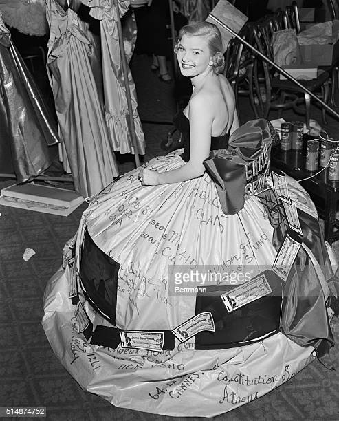 2/17/1953New York NY Mrs Thomas Wyman Jr is shown modeling a gown sponsored by the American Express company at the second annual Mardi Gras Ball...