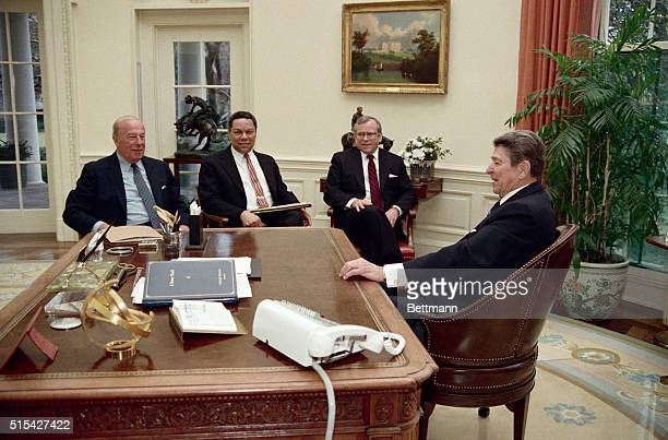 2/19/1988Washington DC Reagan meets with Secretary of State George Schultz in the Oval Office 2/19 to discuss Schultz's trip for a series of...
