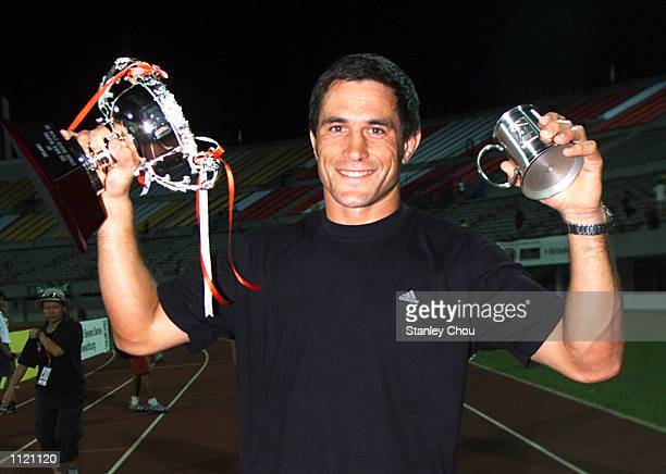 Dallas Seymour Captain of New Zealand celebrates with the Cup after New Zealand defeated Fiji in the final of the Singapore Sevens Cup final during...