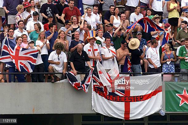 English fans cheer for their team during the Singapore Sevens Cup semifinals between England and New Zealand during the IRB World Rugby Sevens Series...