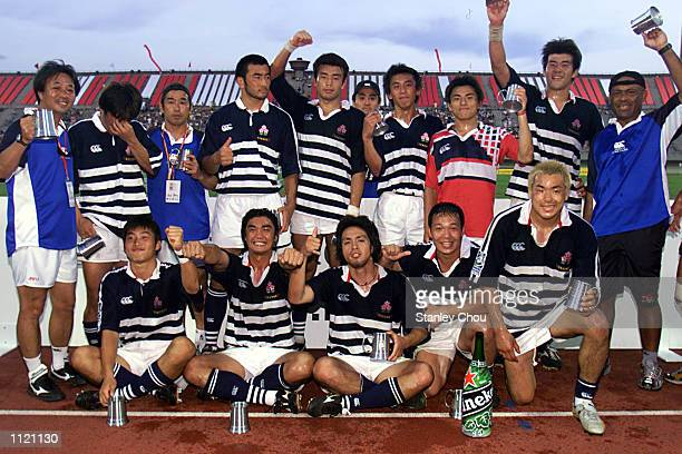 Japan players pose for photographs after they finished as Runnersup during the Singapore Sevens Bowl final between Japan and Wales during the IRB...