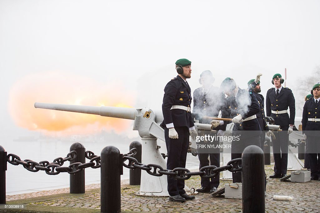 A 21-gun salute is fired in the fog on Skeppsholmen in Stockholm on March 3, 2016, to celebrate the birth of Prince Oscar Carl Olof, son of Sweden's Prince Daniel and Crown Princess Victoria. News Agency / Erik Nylander / Sweden OUT