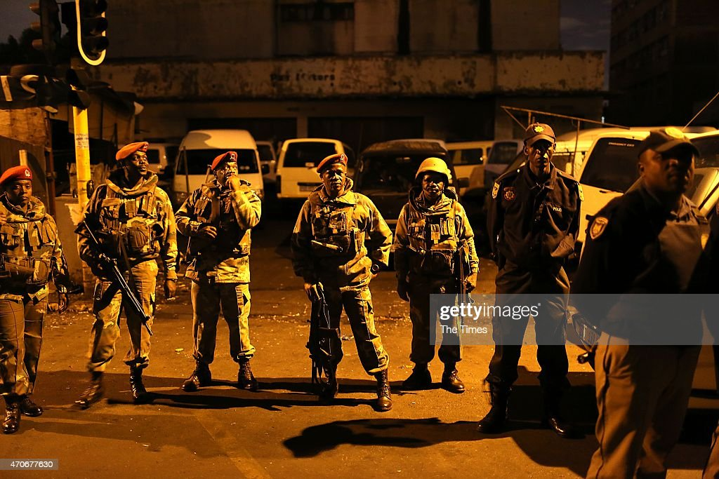 Members of the army during a raid at the Jeppestown hostel on April 21 2015 in Johannesburg South Africa After xenophobic attacks which have rocked...