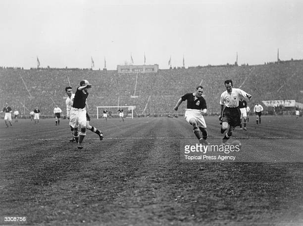 J Hutton of Blackburn Rovers and W H Smith of Huddersfield Town race for the ball during the FA Cup Final at Wembley Stadium Blackburn Rovers went on...