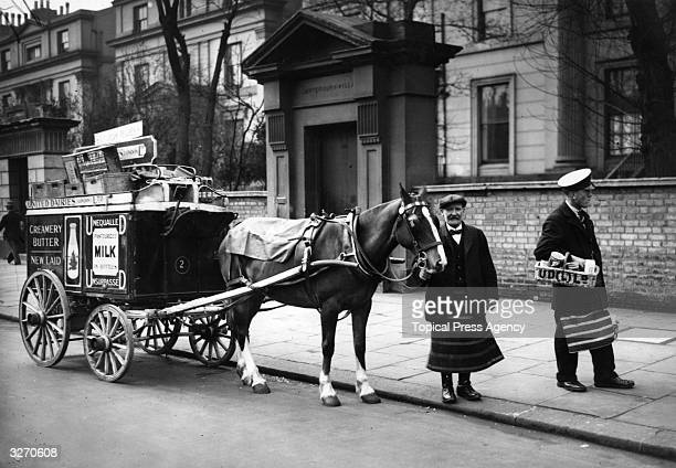 Employees of United Dairies Ltd delivering milk and groceries in Maida Vale London with a pony and fourwheeled cart