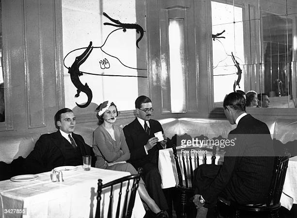 Members of the Bat Club London in the newly decorated premises The decorations have been designed by Gerald La Coste ARIBA and consist of five panels...