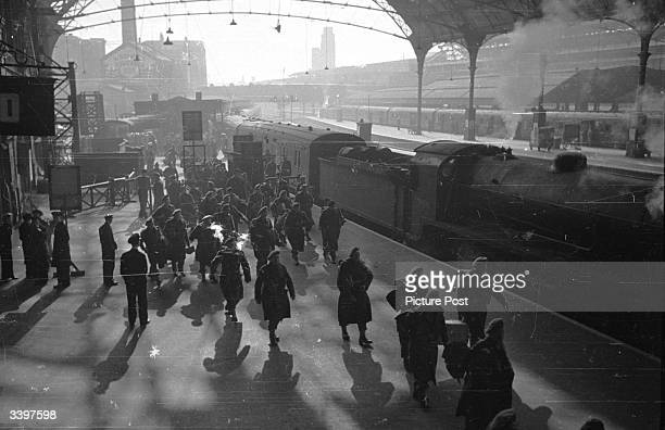Soldiers returning to their friends and family at a London railway station Original Publication Picture Post 1953 How To Welcome A Soldier Home pub...