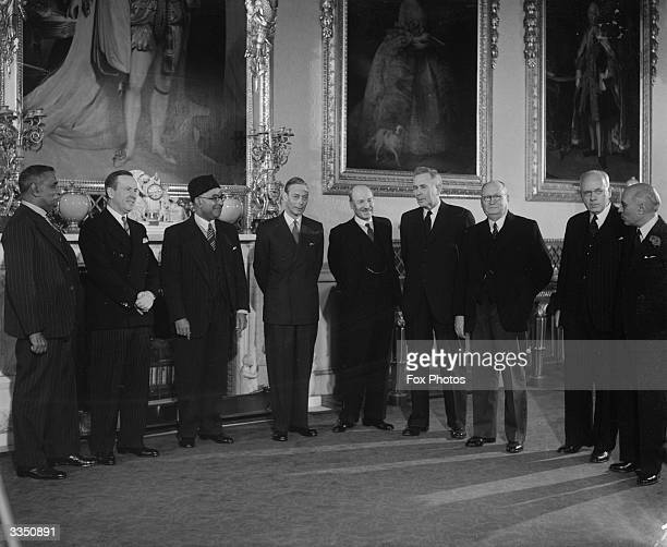 Commonwealth premiers who are in London for the Conference of Commonwealth Prime Ministers along with King George VI at Buckingham Palace From left...