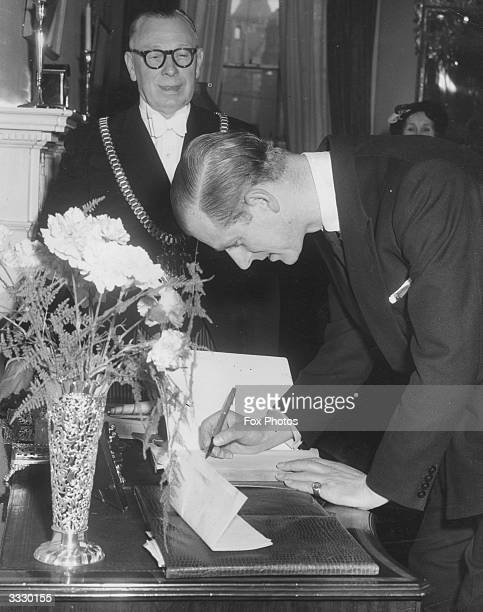 Prince Philip Duke of Edinburgh signing the visitors' book on arrival at the Lord Mayor's Parlour in Liverpool's town hall