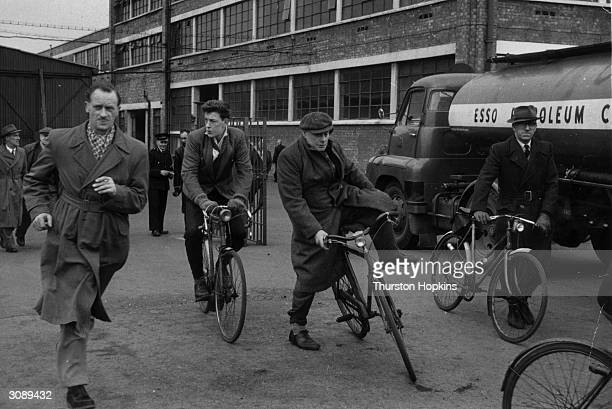 Dismissed factory workers leave their place of work for the last time Original Publication Picture Post Redundancy It Still Means The Sack pub 1956