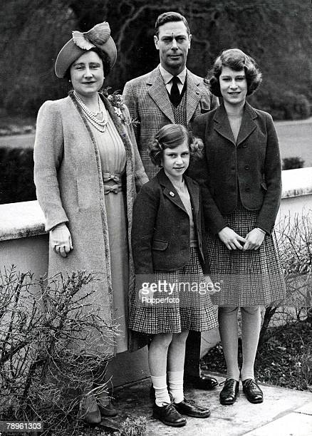 21st April King George VI and Queen Elizabeth with their daughters Princess Elizabeth and Princess Margaret in the grounds of Windsor Castle during...
