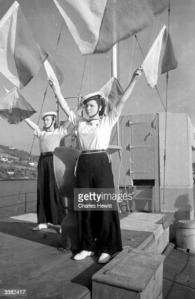 SeaRanger Girl Guides doing their semaphore practice on board the Motor Torpedo Boat 630 moored in the River Dart close to Dartmouth Naval College...