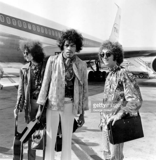 The Jimi Hendrix Experience at London Airport from left to right bass player Noel Redding legendary guitarist Jimi Hendrix and drummer Mitch Mitchell