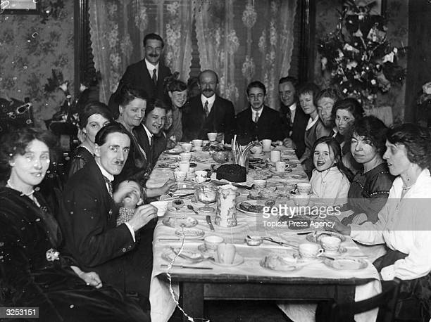 A family sitting down for tea at Christmas time