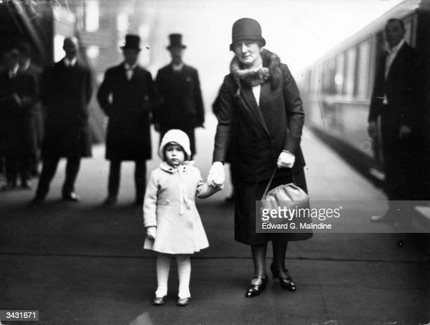 Princess Elizabeth on the platform at King's Cross station about to depart with her Royal grandparents for Christmas holidays at Sandringham