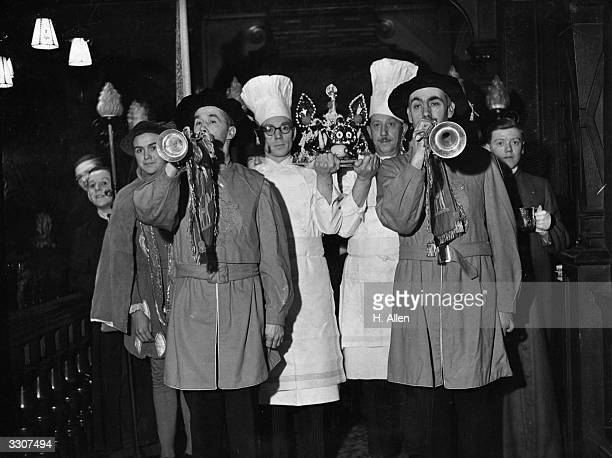 Chefs ceremonially carry in the boar's head accompanied by trumpets at the annual Boar's Head Banquet held at Cutlers' Hall London