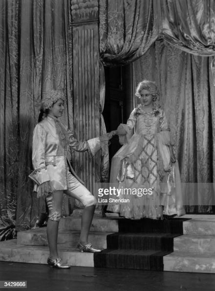 Princess Margaret plays Cinderella to Princess Elizabeth's Prince Charming in a royal pantomime at Windsor Castle