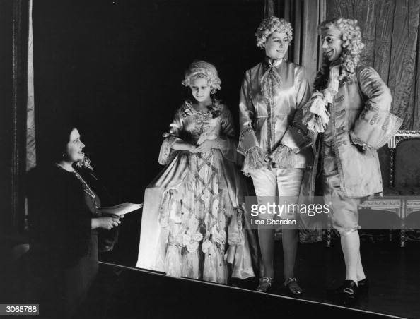 Queen Elizabeth Princess Margaret and Princess Elizabeth during a rehearsal of 'Cinderella the first Royal pantomime at Windsor Castle The two...